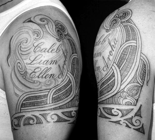 Tribal name design tattoo on shoulder for man