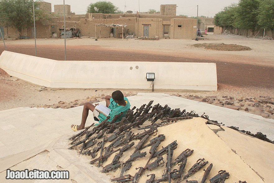 Boy reading the Koran  near the Peace Monument