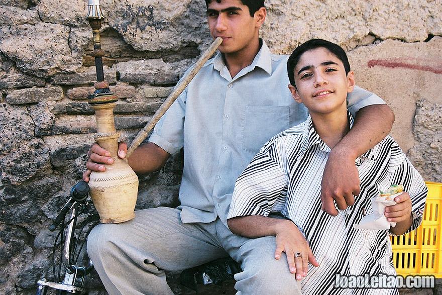 Boys smoking water pipe in Shiraz