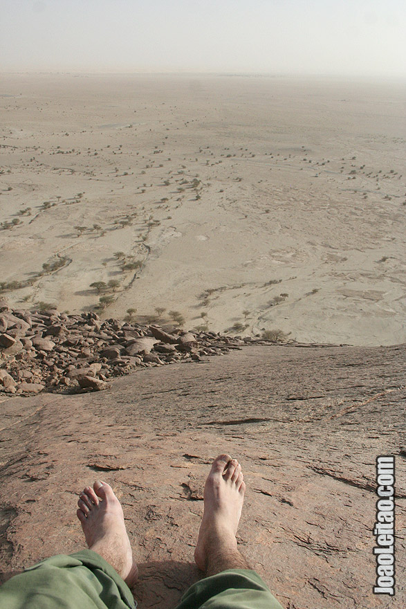 Climbing Ben Amera monolith in Sahara Desert
