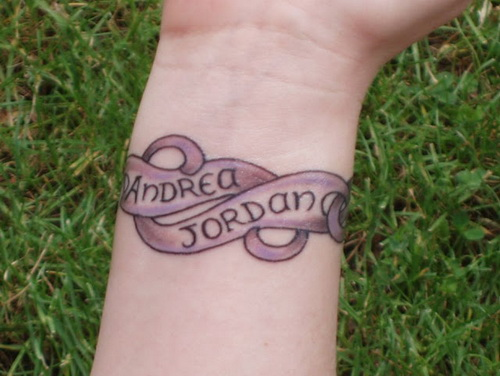 Ornamental bracelet tattoo design with names