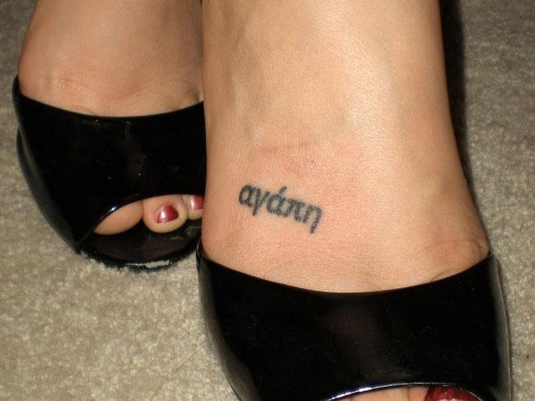 Feminine name tattoo design on foot