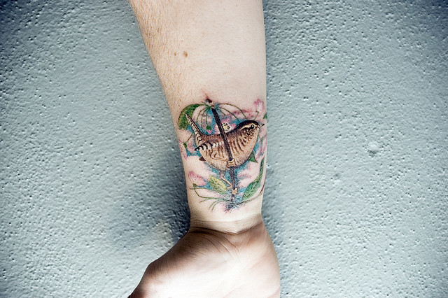 Bird tattoo designs for men – man wrist tattoo