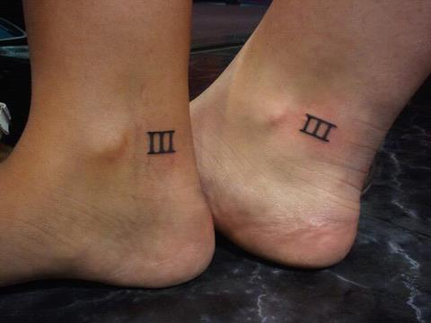 Roman numeral tattoo design on ankle for couple