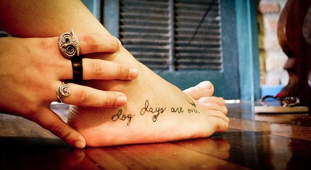 Handwriting style tattoo idea on foot
