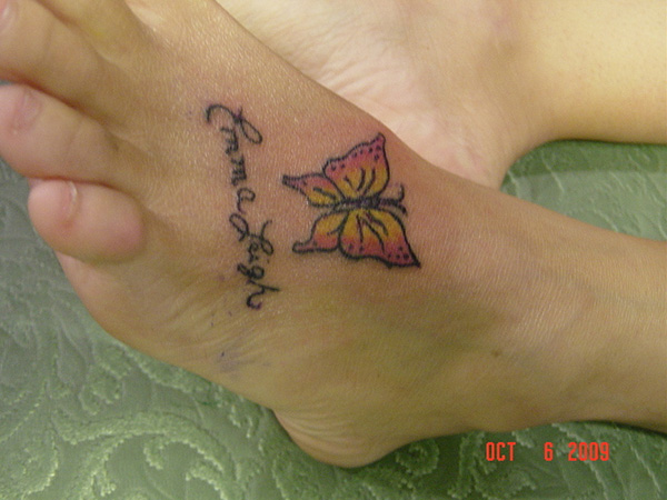 Butterfly and name tattoo design on foot for women