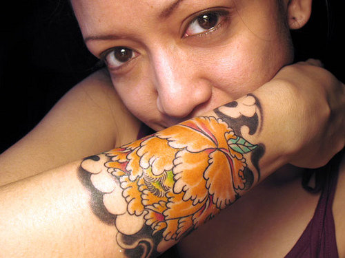 Colorful flower wrist tattoo for women