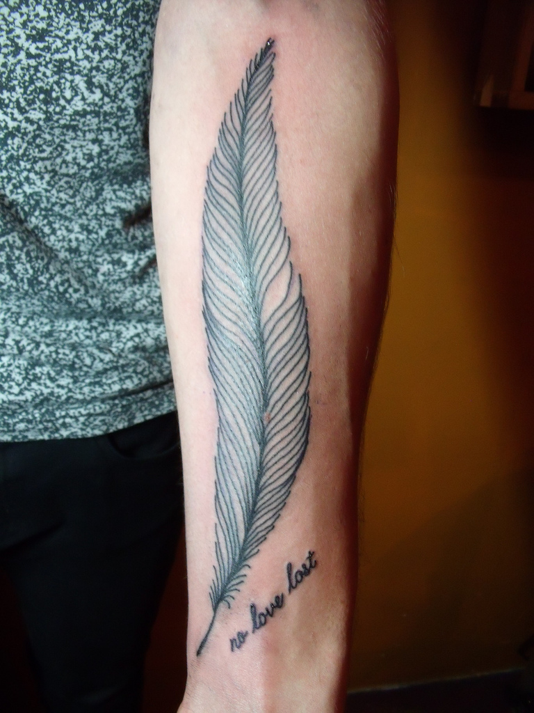Feather tattoo designs on forearm