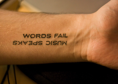 Funny Script Tattoo Idea for Inner Arm