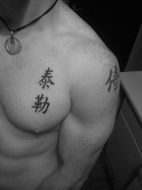 Kanji tattoo design idea on upper chest for man