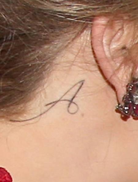 Initial name letter as behind ear tattoo idea