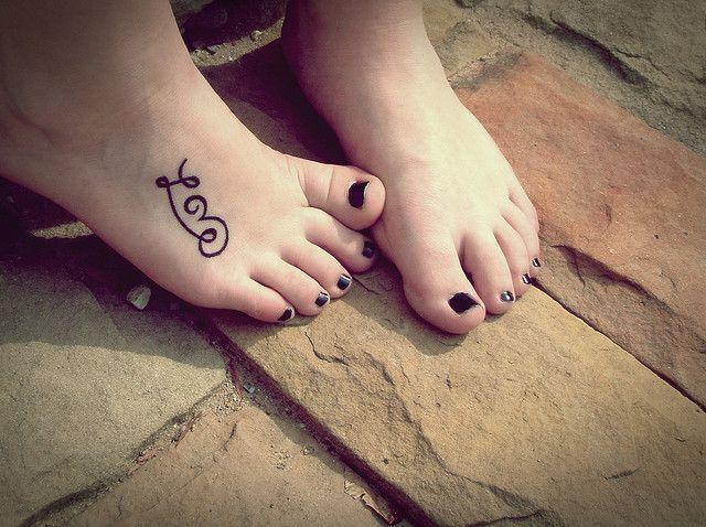 Cute love word name tattoo idea on foot