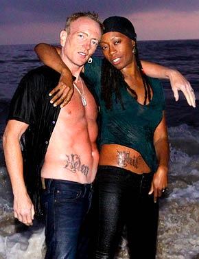 Def Leppard guitarist Phil Collin's stomach tattoo idea for men