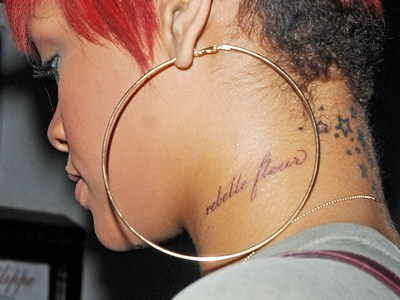 Famous Rihanna's neck tattoo Rebelle Flour