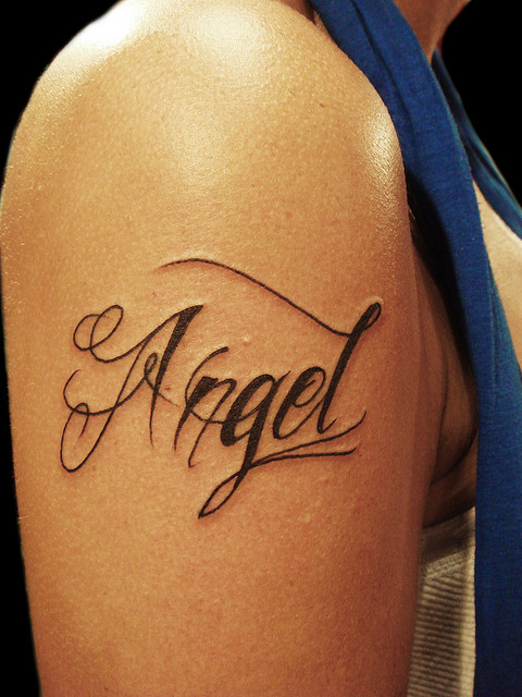 Angel Name design tattoo on shoulder for female