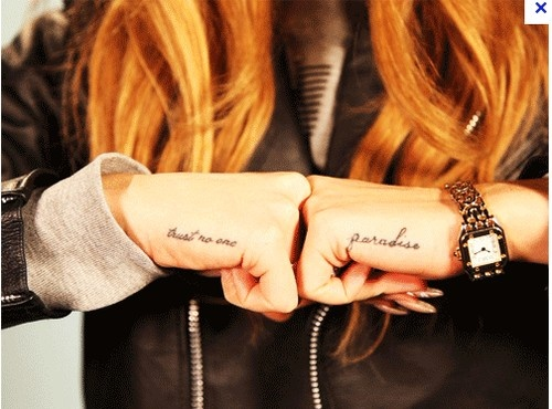 Cool name tattoos on both hands for woman