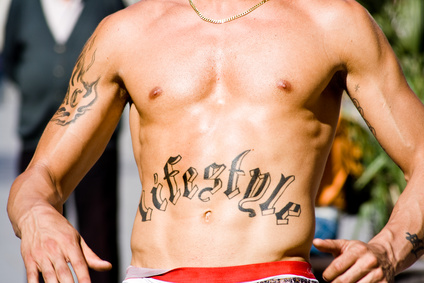 Word Lifestyle tattoo design in the middle of the stomach for men