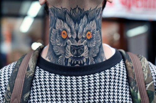 Wolf tattoo designs – man neck tattoo