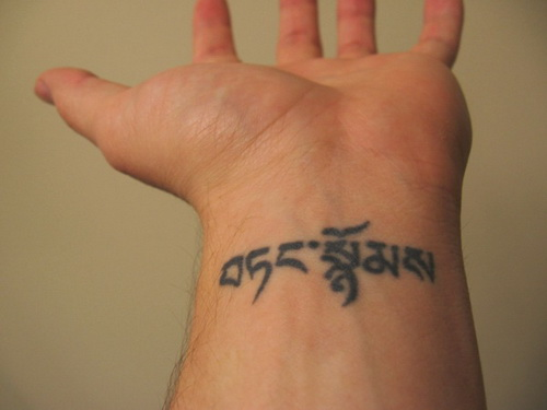 Hebrew alphabet name tattoo design on men's wrist