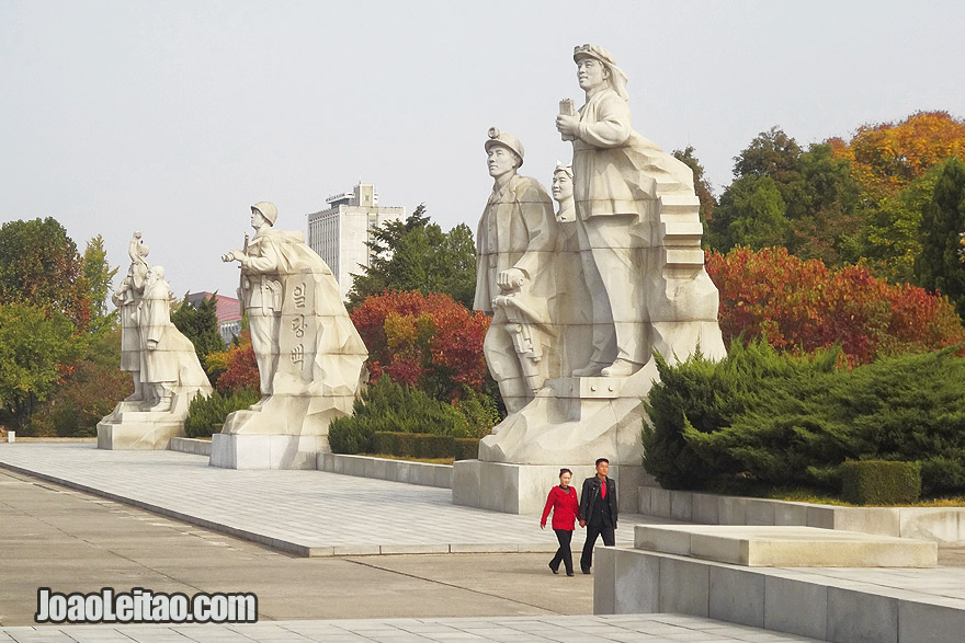 Couple walking in the Tower of Juche Idea complex in Pyongyang.
