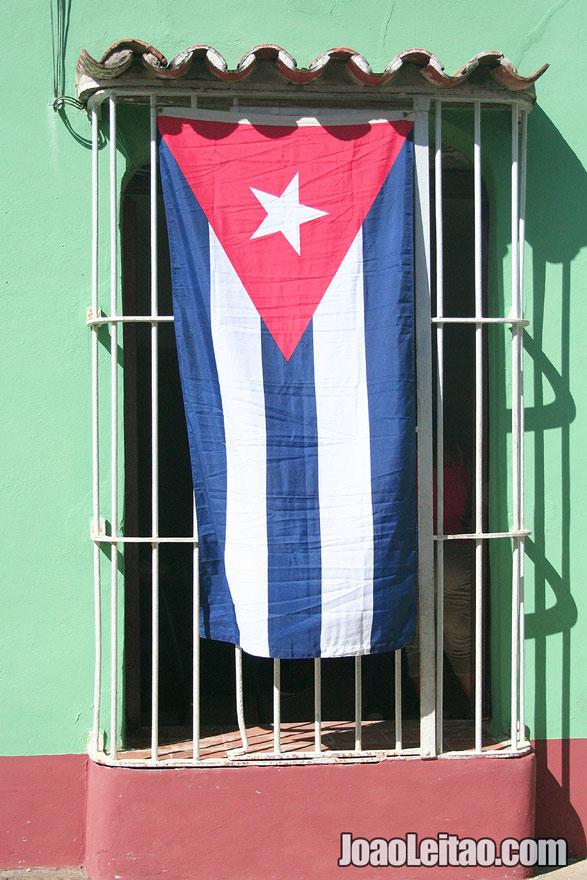 Cuban Flag on a window in Trinidad