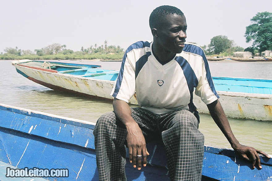 Man on boat to James Island, Gambia