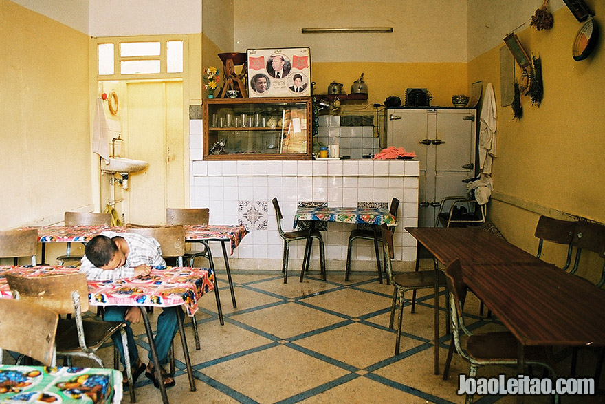 Photo of boy sleeping inside a restaurant, Morocco