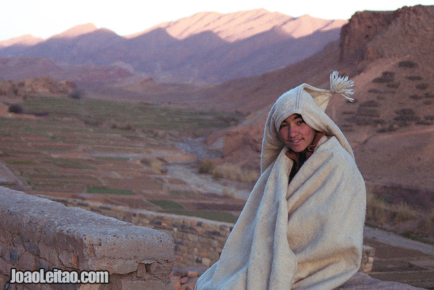 Photo of young boy wearing a traditional anzar in the Atlas Mountains, Morocco