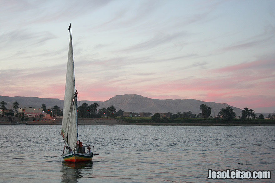 Felucca boat on the Nile river during sunset