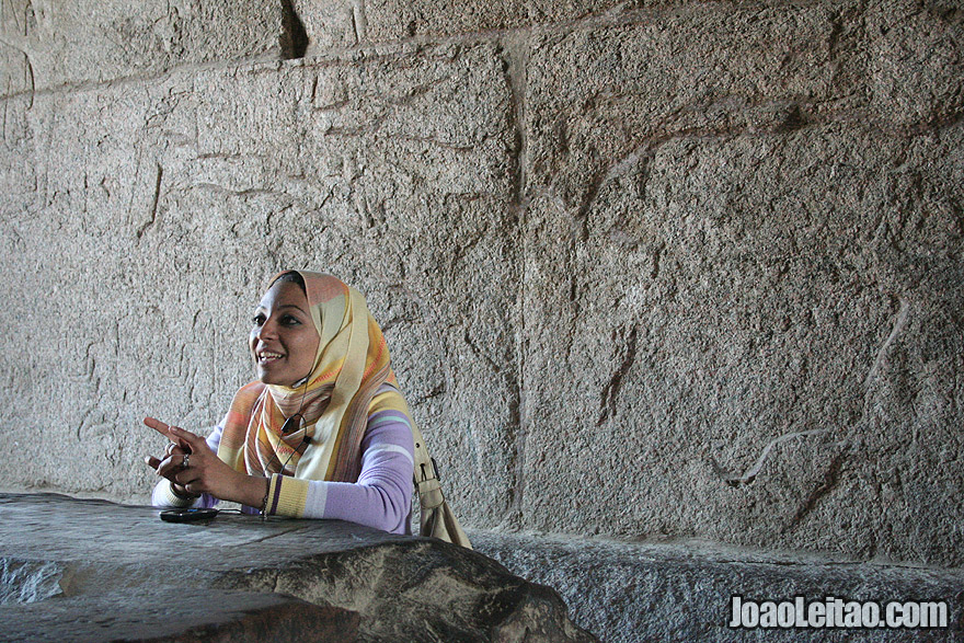Egyptian woman guide explaining the Temple Complex of Karnak in Thebes