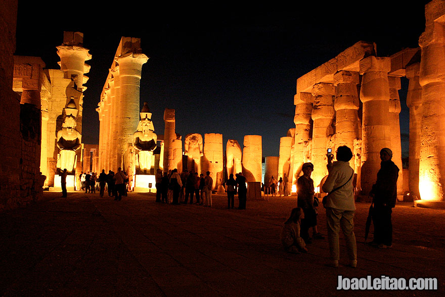Tourists inside Luxor Temple by night