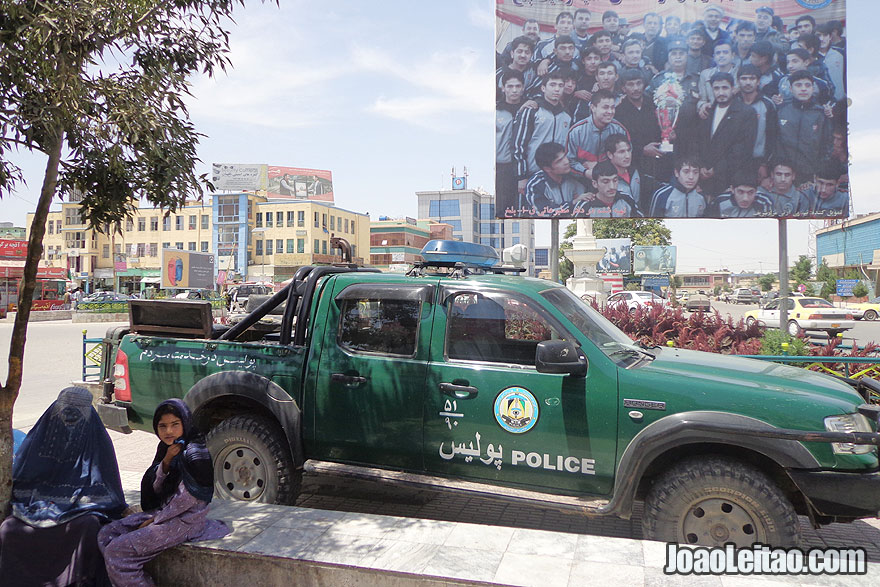 Police car and woman with burqa in the city center