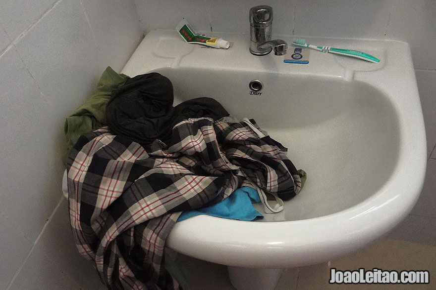 How to Do Laundry While Traveling - Washing clothes in the hotel bathroom sink