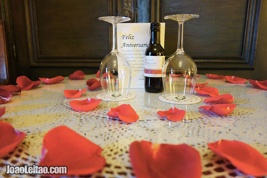 Anniversary card and red wine bottle in Hotel de la Opera