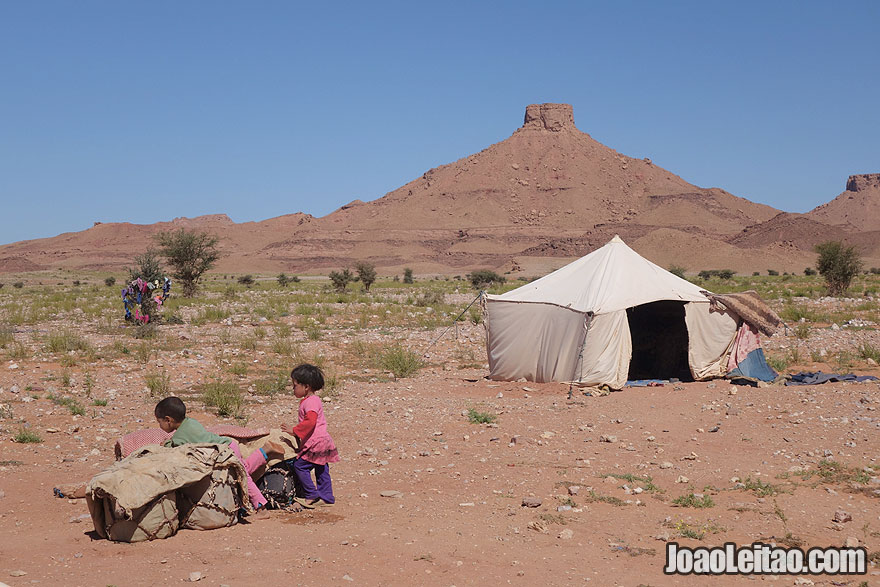 Nomad children playing near tent