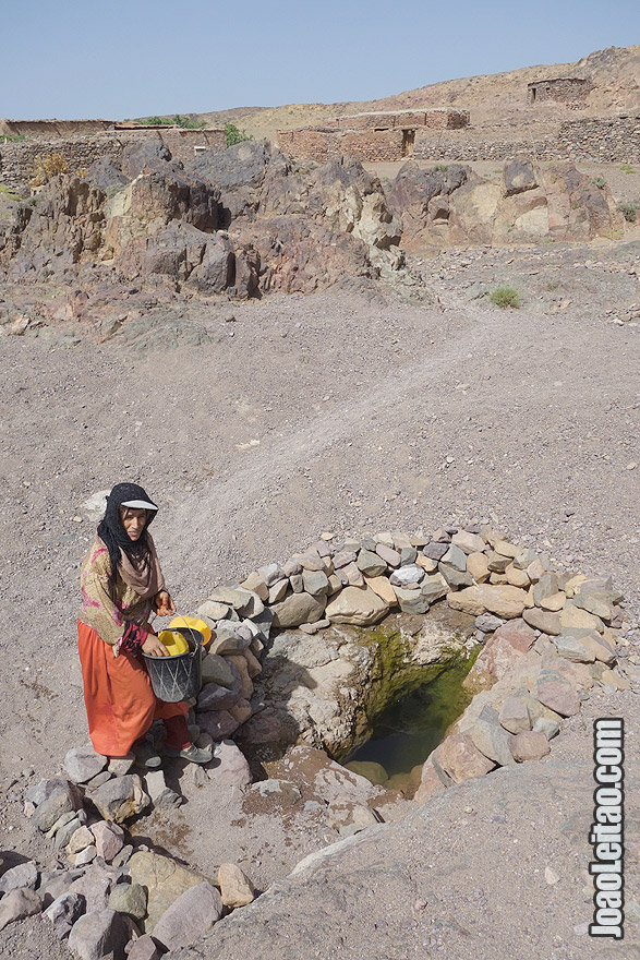 Woman getting water from well in Azib N Oudad