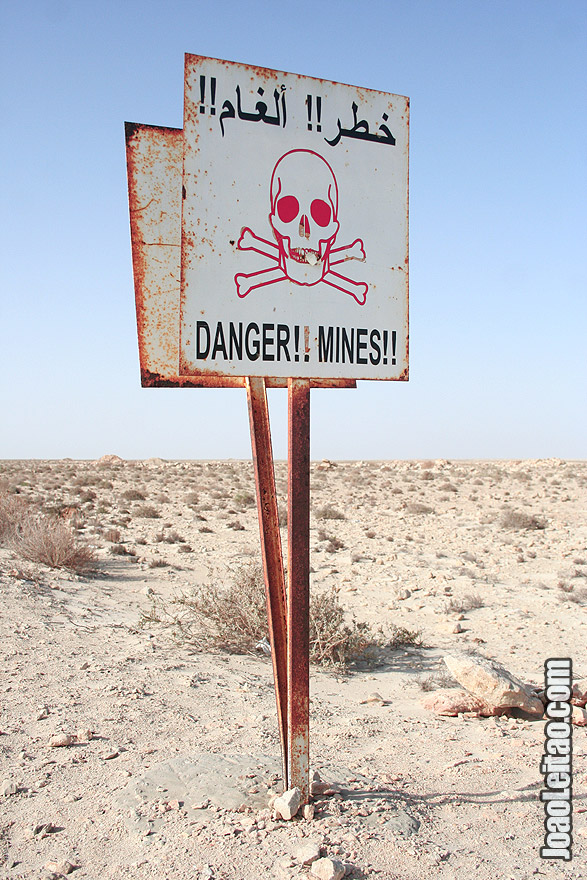 Land mines sign in the desert