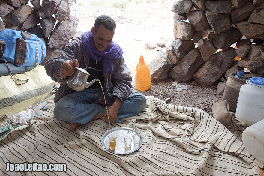 Serving Moroccan tea by friendly man