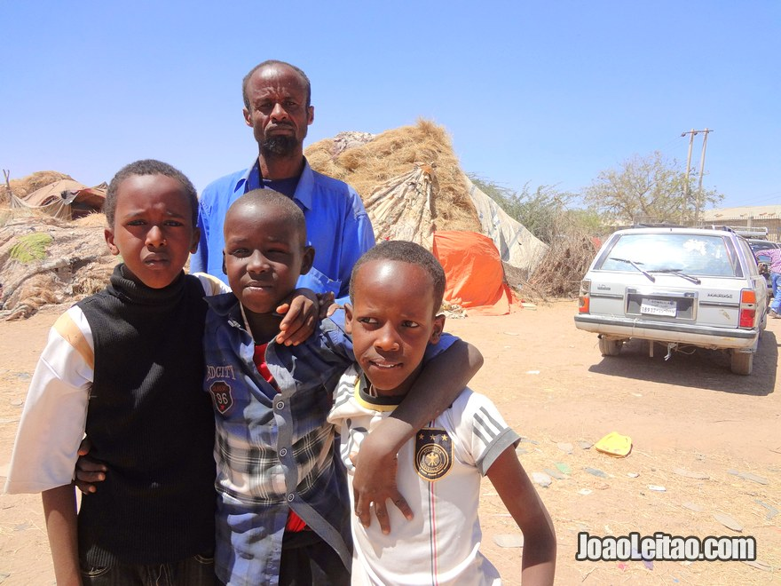 Friendly man and children in Hargeisa animal market