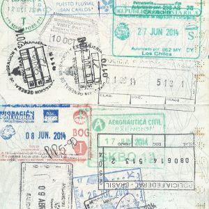 Page of passport full of stamps