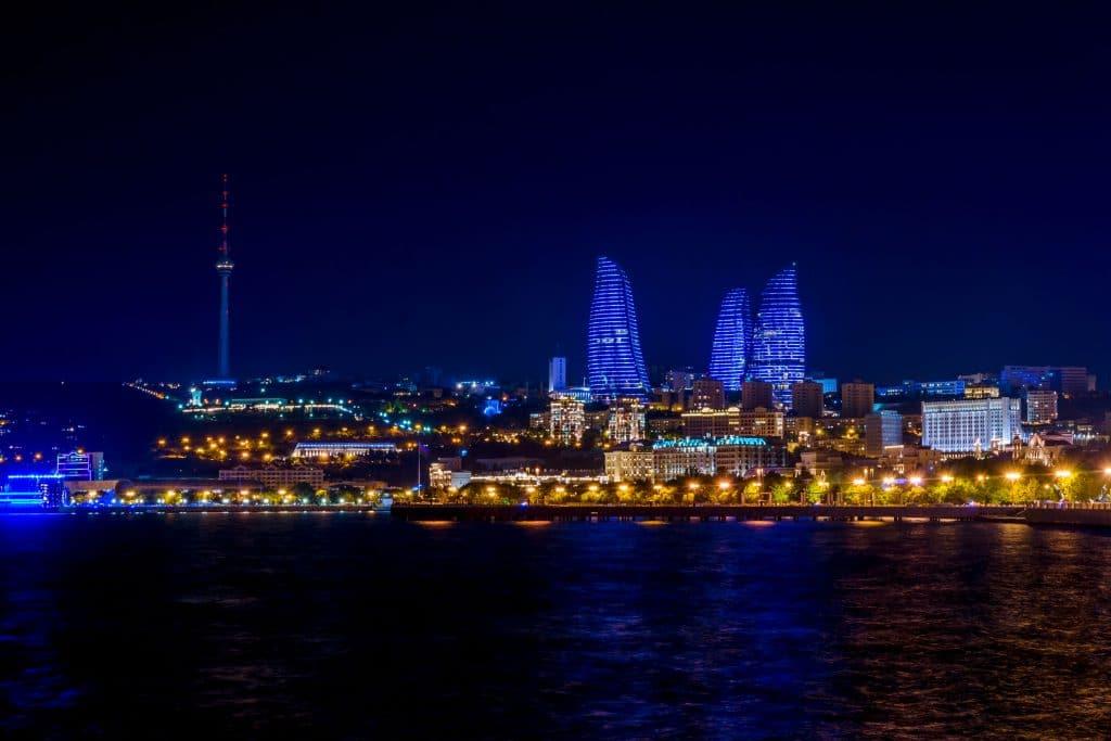 Baku downtown and flame towers illuminated at night